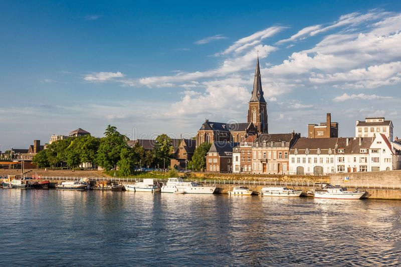 Riverside in Maastricht. A riverside with motorboats in Maastricht. Limburg, the Netherlands. The center of Meuse–Rhine Euro-region, bordering Belgium and royalty free stock image