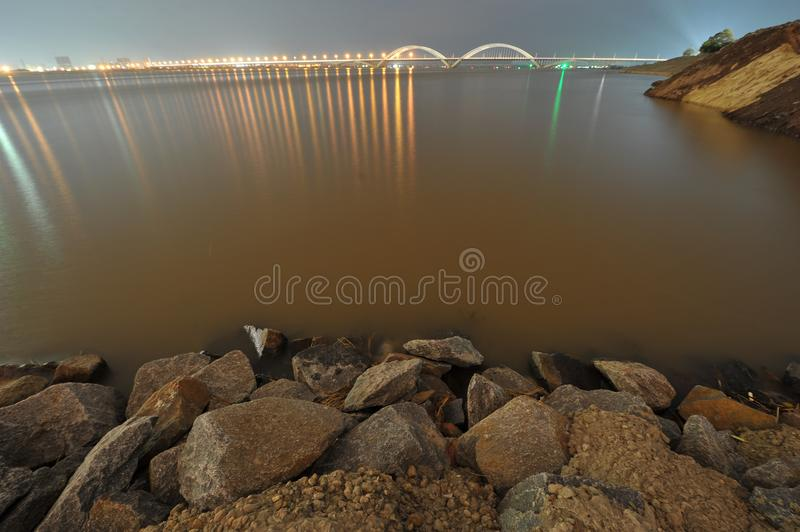 Riverside -urban fringe. The edge of a city, in the distance is the modern tall building and the cross river bridge and the skyline royalty free stock images