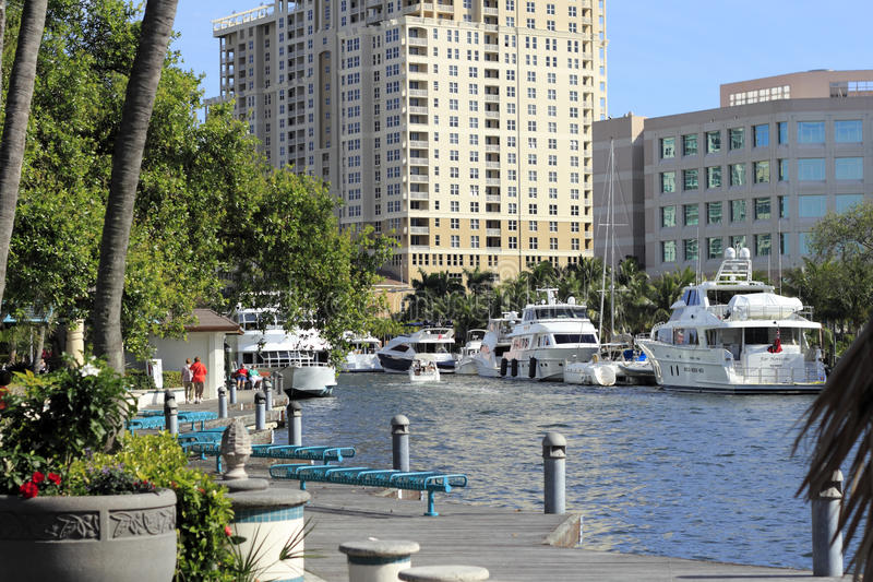 Riverwalk Linear Park. FORT LAUDERDALE, FLORIDA - FEBRUARY 3: People enjoying the Riverwalk Linear Park walkway and river with boats and beautiful views on a royalty free stock photos