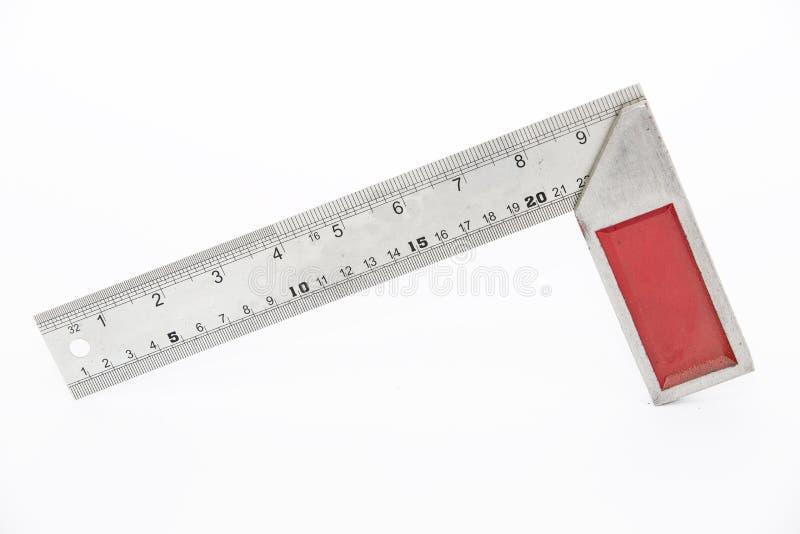 Rivesta di ferro il righello con la barra di angolo, la squadra a triangolo, isolata su un backg bianco immagini stock libere da diritti