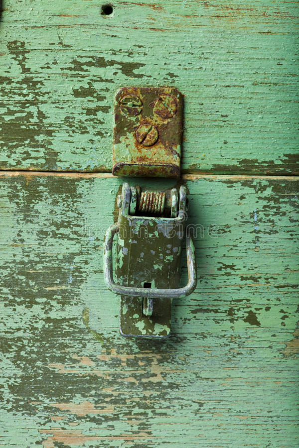 Download Rivet on the green wood stock photo. Image of push, open - 23492890