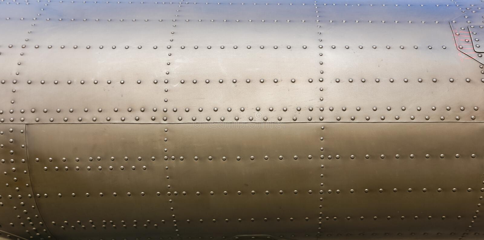 Riveted metal from aircraft. Background stock images