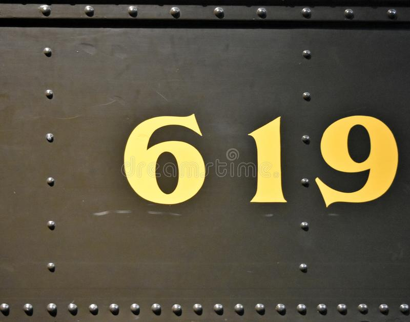 Rivets and numbers on a railway car, Industrial texture. Army green color. The natural shape of this design could be used for multiple design choices stock image
