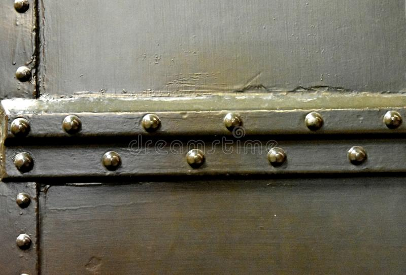 Rivets on a railway car, Industrial texture. Army green color. The natural shape of this design could be used for multiple design choices royalty free stock photos