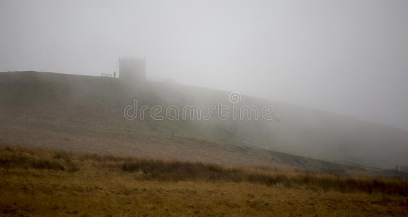 Rivington Pike in mist royalty free stock image