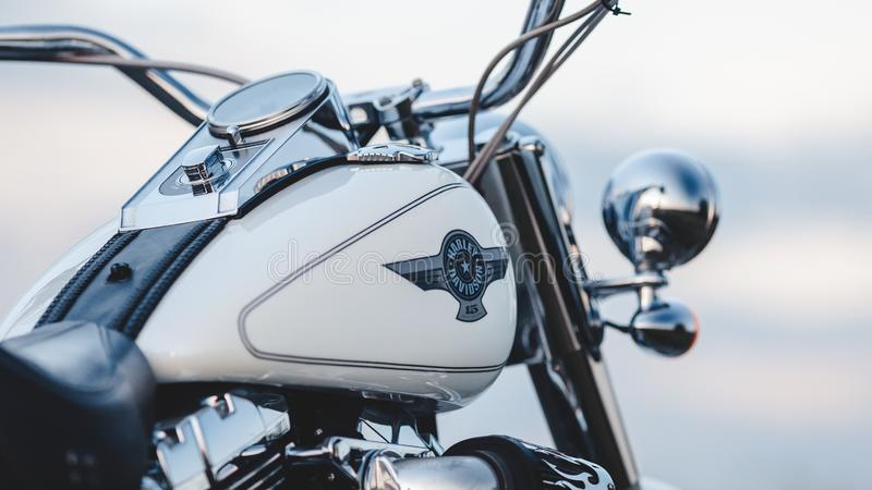 Rivne, Ukraine - September 23, 2019: Harley-Davidson Fat Boy motorcycle detail. Motorcycle at the old town road field stock image