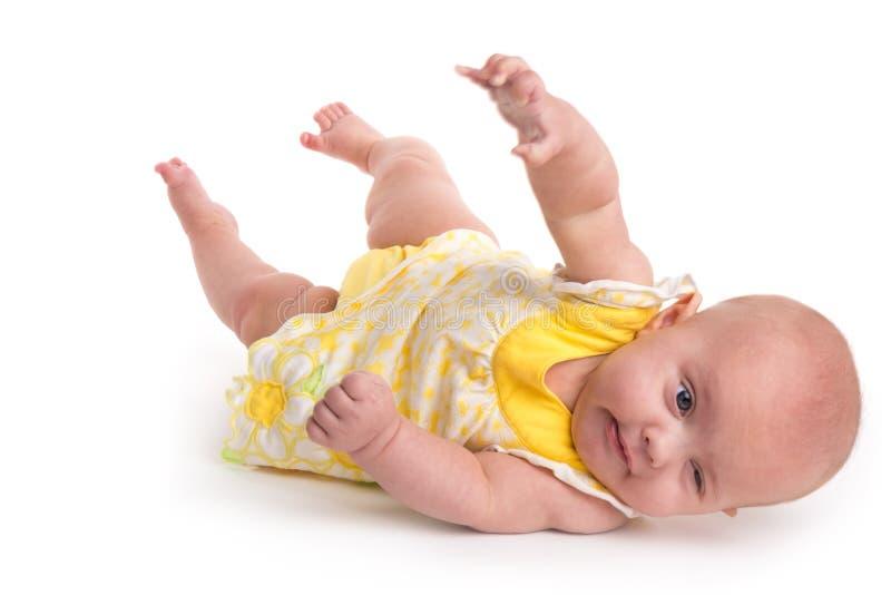 Rivoltarsi sveglio del bambino isolato su bianco fotografie stock libere da diritti