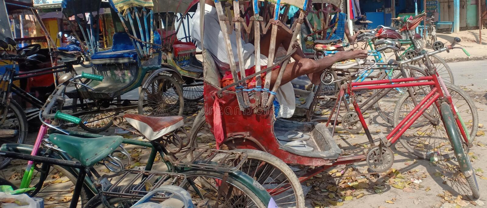 Rixa is comfortable transportation equipment for humane or ludguage  in madhubani India. This is three wheeler bicycle used for multipurpose and one driving stock photo