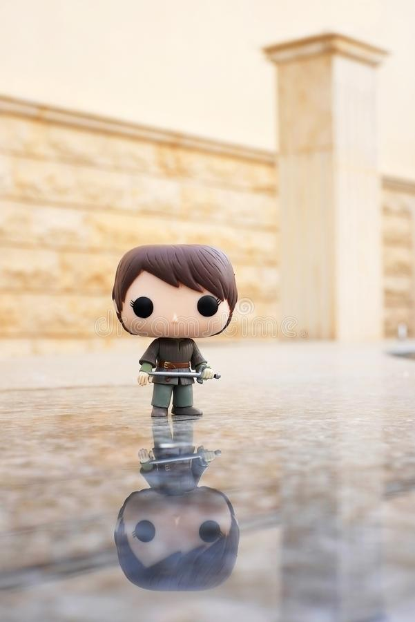 Riyadh, KSA - April 7, 2017: Game of Thrones Character Arya Stark portrayed Maise Williams by Funko Pop Vinyl Toys with her sword. Character Arya Stark is stock image