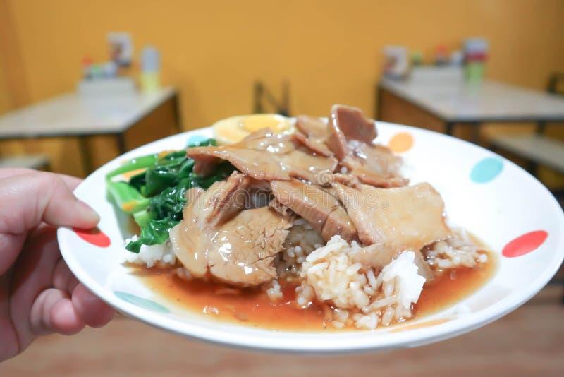 Riz avec du porc cuit photo libre de droits