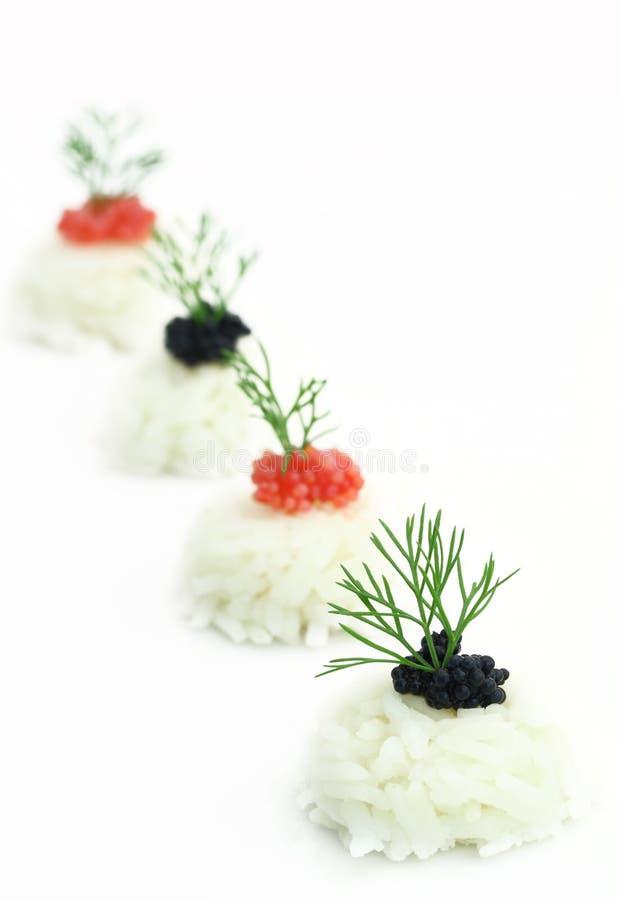 Riz avec le caviar et l'anis images stock