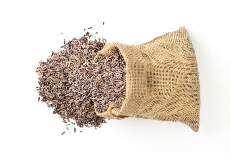 Riz brun dans le sac de sac image libre de droits