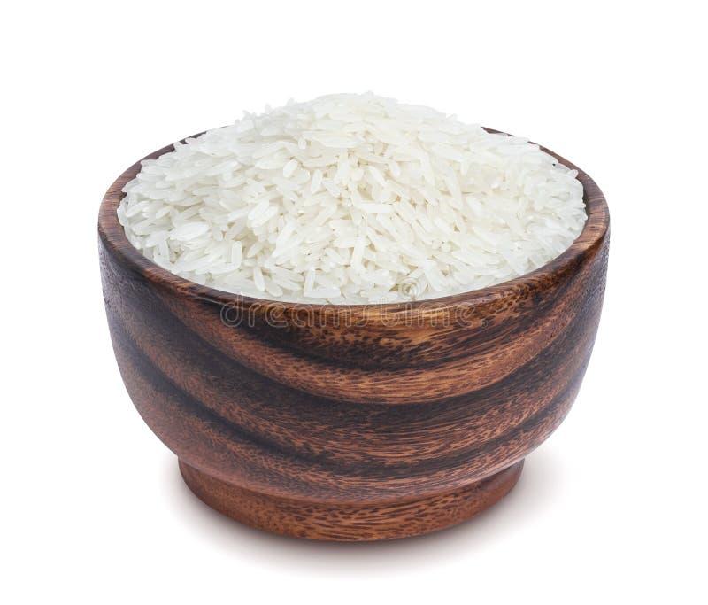 Riz de jasmin dans la cuvette en bois d'isolement sur le fond blanc image libre de droits
