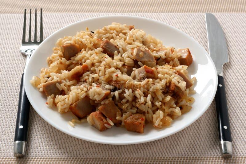 Riz frit avec du porc images stock