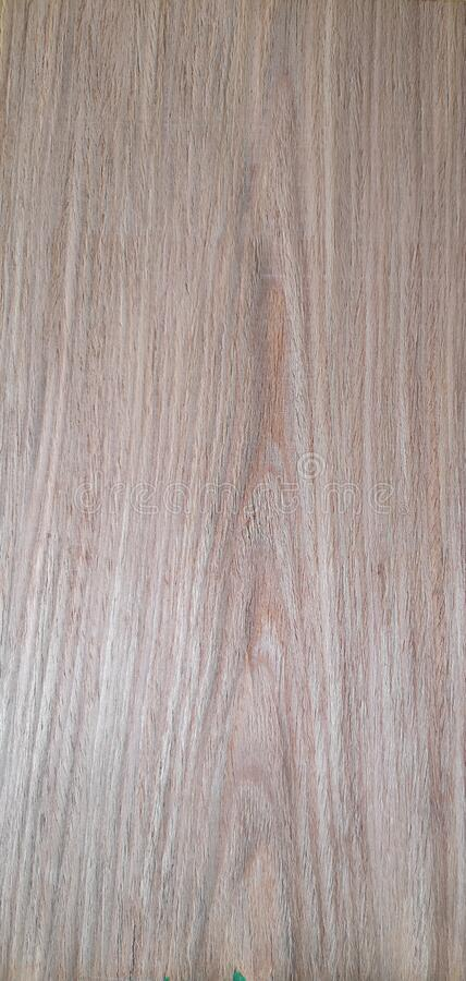 Rlmo oak wood, Veneer Pattern brown wooden material finish surface furniture burr texture wall background. Surrounding royalty free stock photo