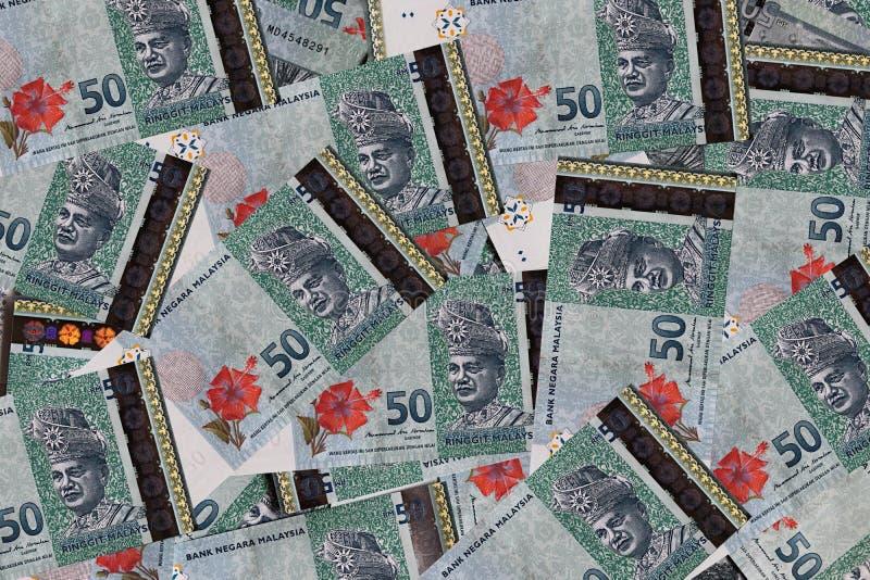 RM50 Ringgit Malaysian Bank Notes. Copies of Malaysian RM50 Ringgit banknotes spread out flat stock image