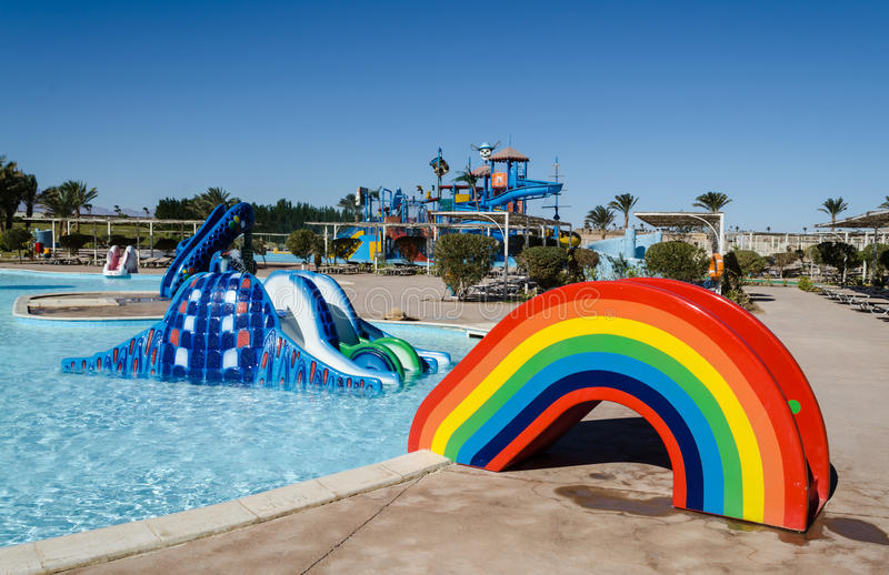Water park, the hills for the youngest children in the form of a rainbow. Madinat Makadi – January 2016: Water park, the hills for the youngest children royalty free stock images