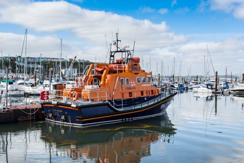 RNLI Rescue. A Royal National Lifeboat Institution (RNLI) vessel docked at Brixham Harbourside, United Kingdom stock photo