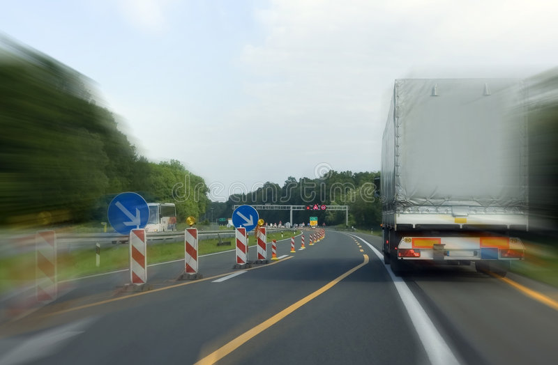 Road. Cargo transport on highway with warning signs stock photography