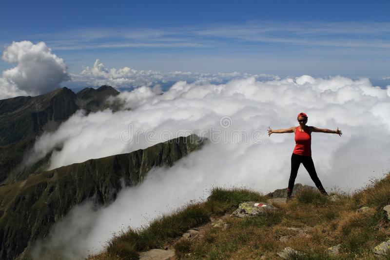 Feeling free above clouds stock photography