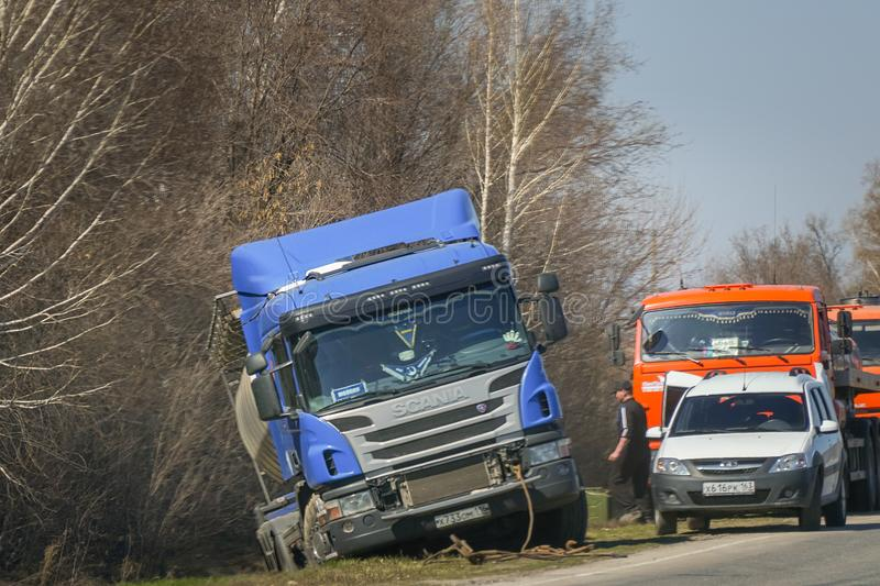 A road accident. Fuel truck crashed out of the way into a ditch stock image