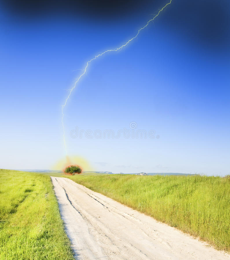 Road amongst green meadow royalty free stock image