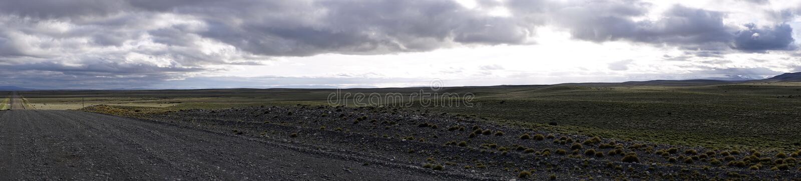 Road in Argentinian Patagonia and Horizon Line. Rural road in Argentinan Patagonia. Panorama. Horizon line royalty free stock photography