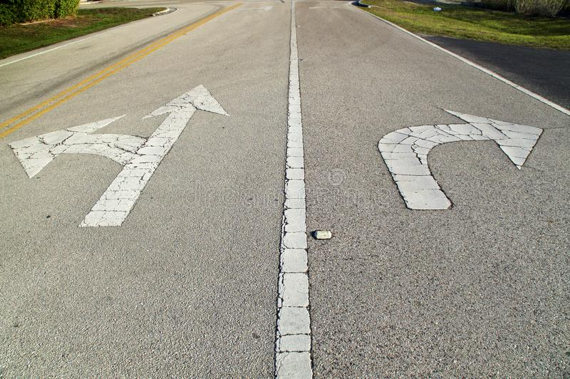 Road with arrows pointing straight and left and right royalty free stock photos