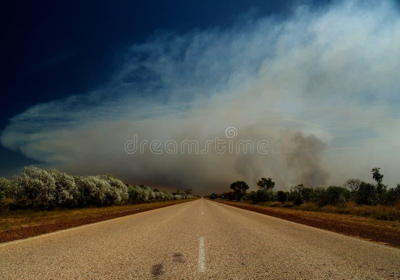 Road of Australia, bush fire stock photography