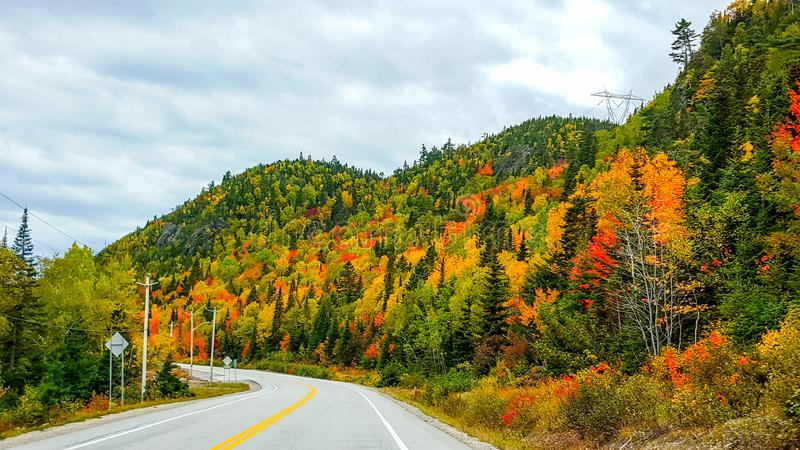 On the road, autumn colors, Tadoussac Quebec stock photo