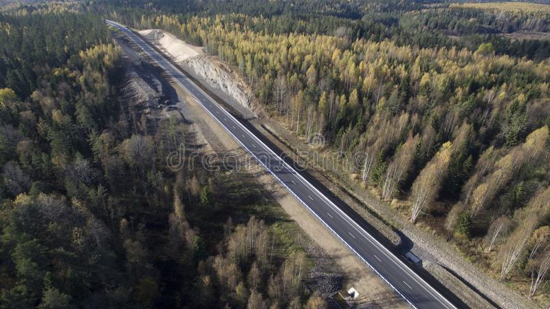 Road in the autumn forest. Travelling in northern forest royalty free stock photo