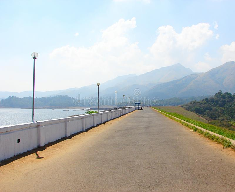 Road at Banasura Sagar Dam with Hills in Background, Wayanad, Kerala, India. This is a photograph of a road at Banasura Sagar dam - the largest earth dam in stock image