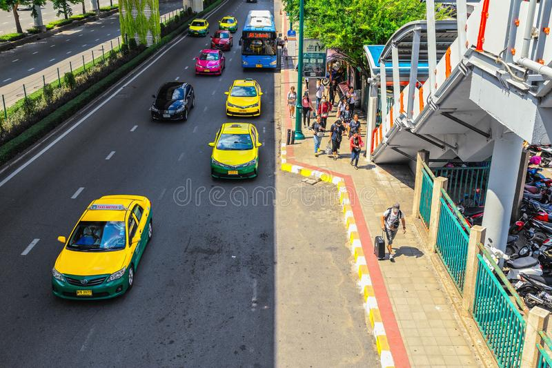 Road in Bangkok at Chatuchak Park. Bridge overpass for connecting trains and condos stock photo