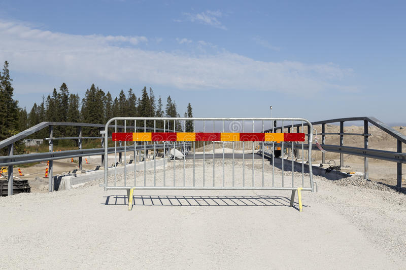 The road barrier. A road barrier in front of a bridge on a construction site stock images