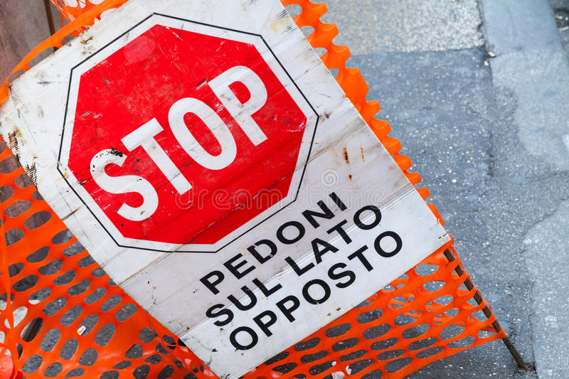 Road barrier with stop sign and text on Italian stock images