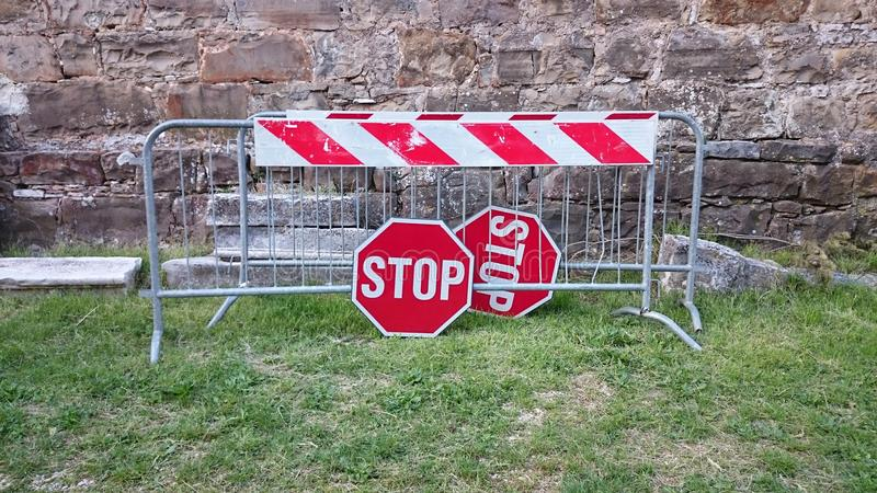 Road barriers and stop signs. Placed on the grass royalty free stock photos