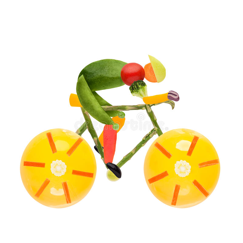 Road bike cycling. Fruits and vegetables in the shape of a male cyclist on a road bike royalty free stock images