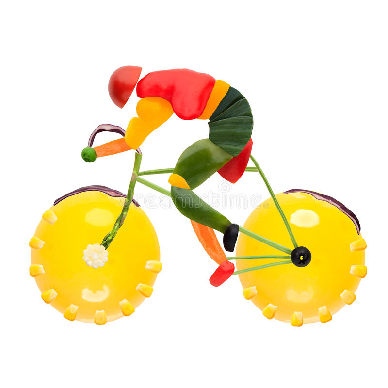 Road bike cycling. Fruits and vegetables in the shape of a male cyclist on a road bike stock photography