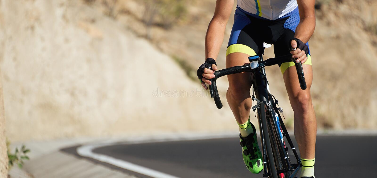 Road bike cyclist man cycling. Athlete on a race cycle stock photography