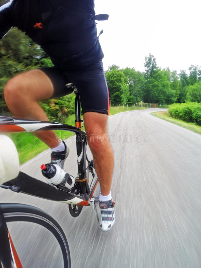 Download Road Bike; Male Cyclist Riding A Racing Bike Downhill Stock Image - Image: 54485419