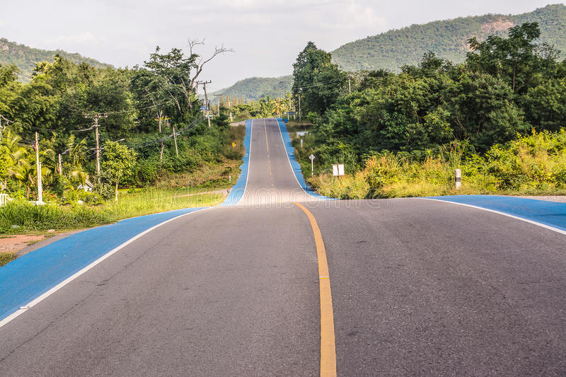 Road and Bike track. In the countryside royalty free stock image