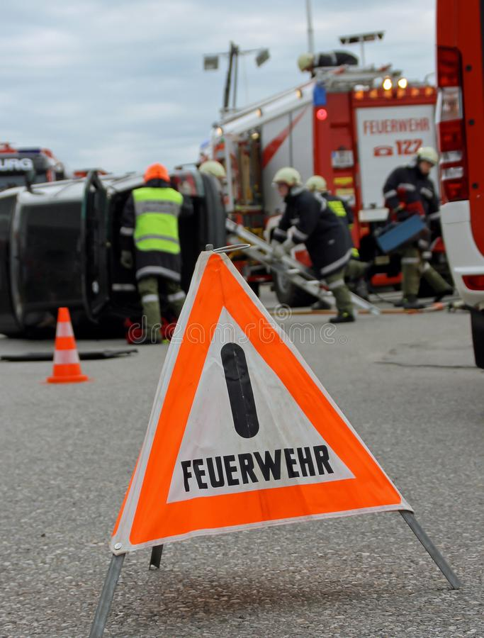 Road blocked by german fire department. Warning sign with the German word `Feuerwehr` in English `Fire Department royalty free stock photo