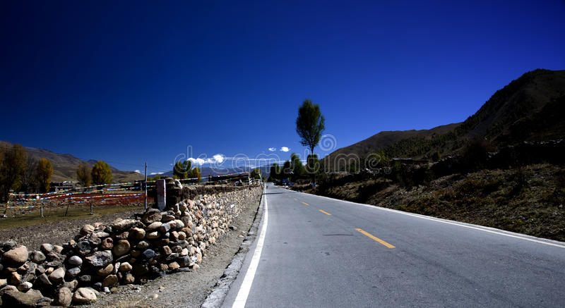 Road in the blue sky royalty free stock image