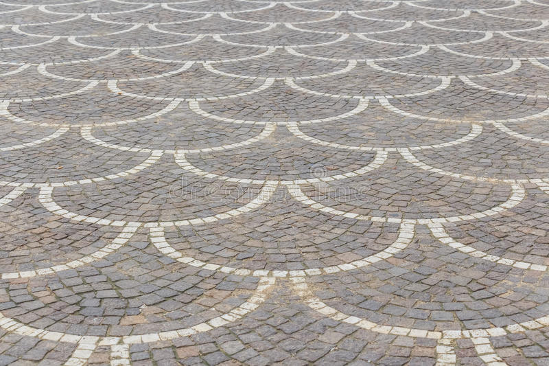 Road bricks in oriental style. Texture of road surface made grey pave stones with oriental ornament royalty free stock image