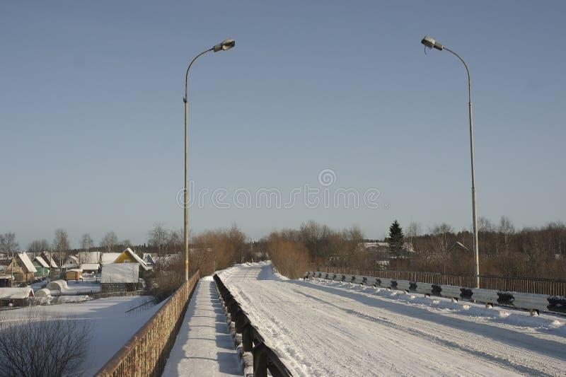 The road bridge across the river. Road bridge over river in winter royalty free stock photos