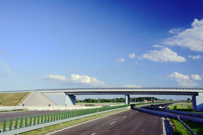Road bridge over the highway under construction stock photo