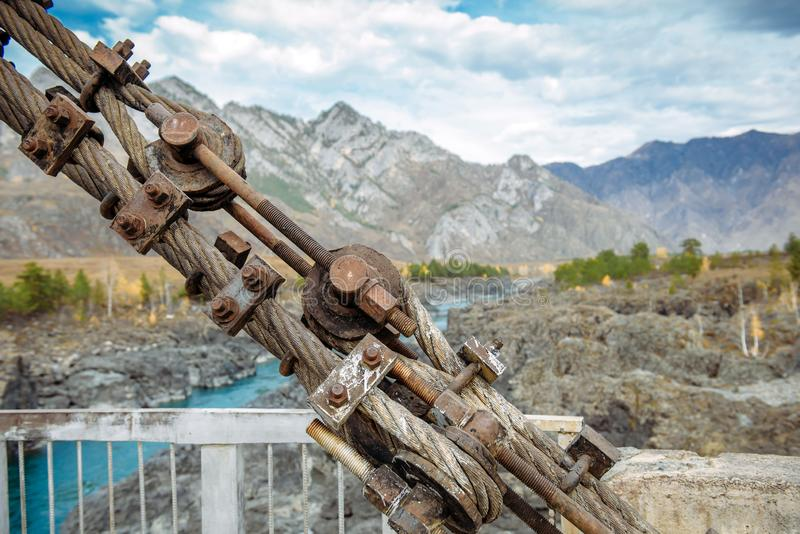 Road bridge over the river in the mountains, metal structure close-up. Location Gorny Altai, Siberia, Russia royalty free stock image