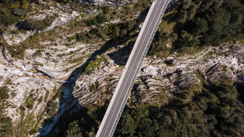 Road Bridge Over Valley, Mangart, Slovenia. Aerial Top Down Drone View stock image