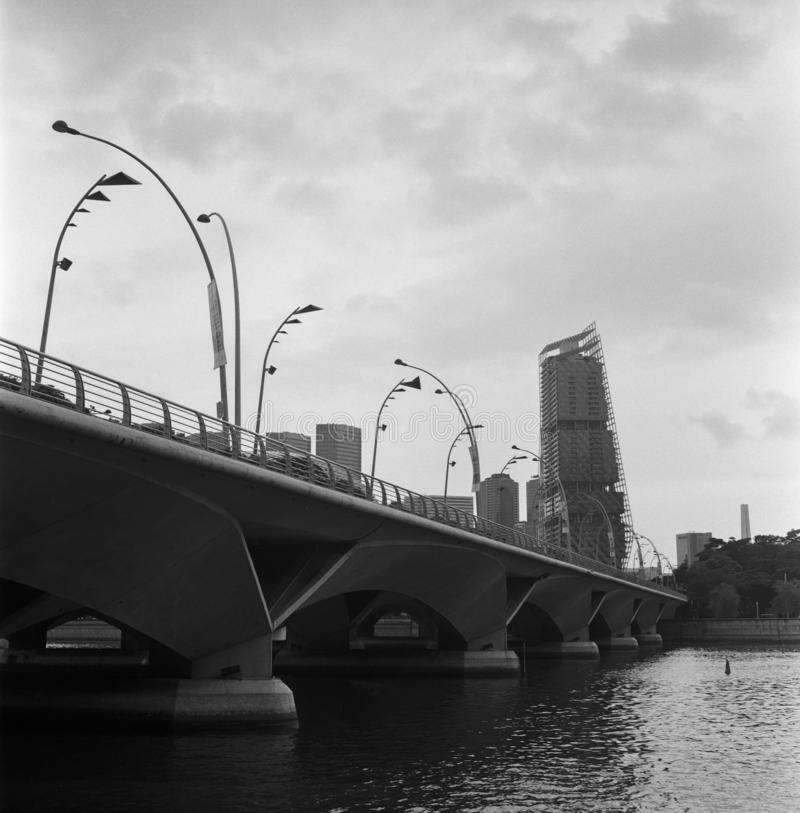 A road bridge on the Singapore river in black and white analogue film photography stock photography