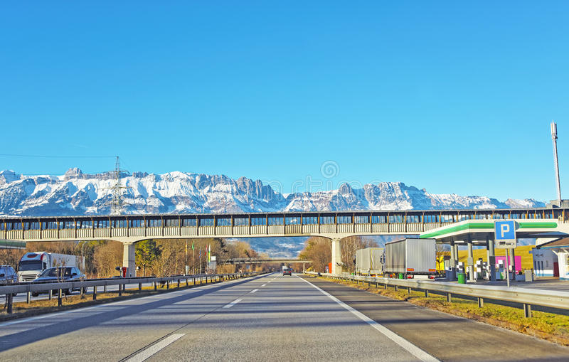 Road and bridge in snow covered Swiss mountains in winter. Switzerland is a country in Europe. Switzerland has a high mountain range, from the Alps to Jura stock photo